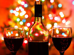 christmas wine image a bottle of wine with christmas lights in the