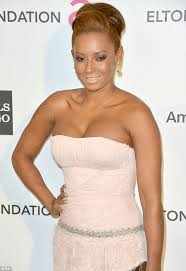 what to wear with a light pink dress mel b goes overboard with the pale pink lipstick as she heads to