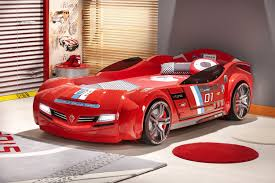 cool red childrens racing car bed with mattress beside window with