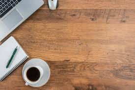 fond ecran bureau tasse d ordinateur portable de carnet et de café sur le bureau de