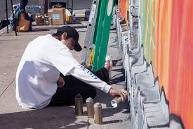 the writing on the wall it s graffiti versus murals in san mike hendrickson oscar davalos upper right and former and current taggers paint a