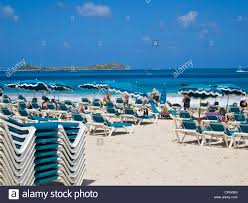 Chairs On A Beach Sun Bathers On Beach Chairs On Orient Bay Or Orient Beach St
