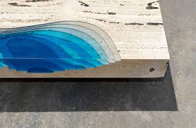 cut travertine marble and resin merge to create u0027lagoon u0027 tables