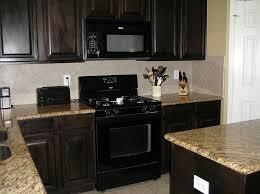 small black cabinet with doors panel glass door over panel glass window dark kitchen cabinet