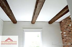 painting wood ceiling beams white wood beam ceiling ideas with a