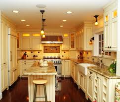 kashmir gold granite kitchen traditional with beadboard cabinet