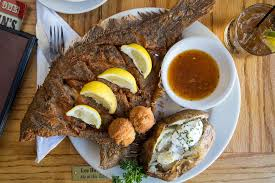 is hyman s a tourist trap a beloved classic or perhaps an click to enlarge hyman s whole flounder with a baked potato jonathan boncek