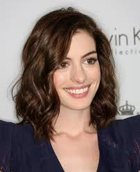 hairstyle for below the shoulder medium length hair highlights with caramel color