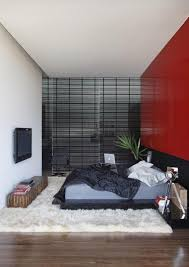Red Feature Wall In Bedroom This House Appears To Be A Stack Of Blocks Piled On Top Of Each