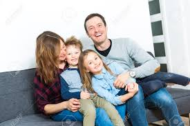 a nice family sit on the livingroom sofa stock photo picture and