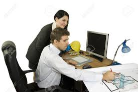 architect man showing his colleague woman a plan for house and