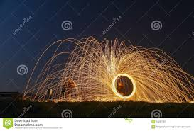 Light Painting Landscape Photography by Light Painting With Fire Circles And Umbrella Stock Photo Image