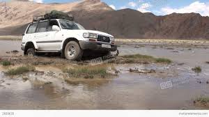 jeep stuck in mud landcruiser jeep stuck in swamp central asia stock video footage
