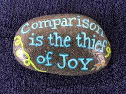 comparison is the thief of joy tr hand painted rock by caroline
