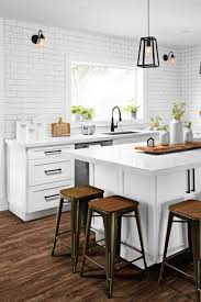 white shaker kitchen cabinets with white subway tile backsplash 70 white cabinets with white countertop going out of