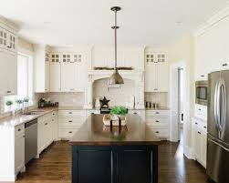 kitchen with black island and white cabinets island top farmhouse kitchen design white farmhouse