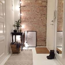exposed brick wall lighting 30 trendy brick wall ideas for entryways digsdigs