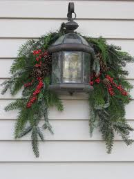 window wreaths this lantern and swag look for outdoor decorating christmas