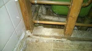 plumbing basement bathtub straddling a crater home improvement