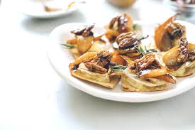 baked canapes baked brie rosemary caramelized pear canapés kale and caramel