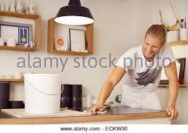 Cleaning Table Stock Images Royalty by Young Worker Cleaning Table In Restaurant Stock Photo Royalty