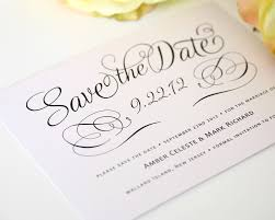simple save the date card in white black with romantic script for