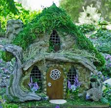 love the driftwood detail on this celtic fairy house the green