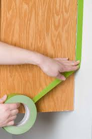 get the look new kitchen cabinets easy way taping off kitchen cabinet frames for refinishing project