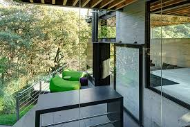 Outdoor Glass Room - outdoor elevated glass walkway connects two sections of house