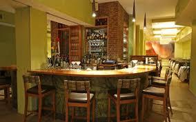ritzy home mini bar design curve shape bar counter brown wooden
