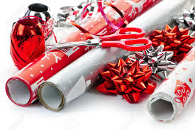 rolls of wrapping paper with ribbons bows and scissors