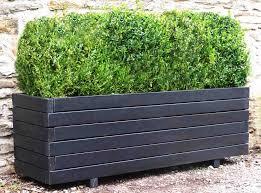 large wooden barrel planters margarite gardens