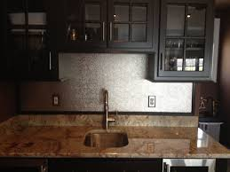 the stainless steel backsplash was just installed hammered