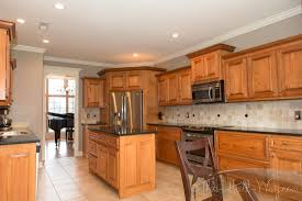 Kitchen Cabinets Trim by Behr Perfect Taupe Walls Maple Cabinets Tile Floor White Trim