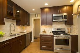 contemporary kitchen with flat panel cabinets u0026 subway tile in