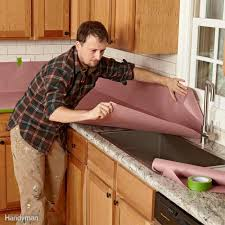 painting wood kitchen cabinet doors 20 tips on how to paint kitchen cabinets family handyman