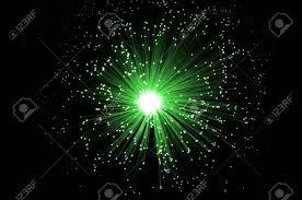 fiber optic light strands overhead of illuminated green fiber optic light strands against