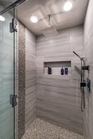 top 25 best shower heads ideas on pinterest steam showers round tiles give a pebbled look and feel to this stylish walk in shower with