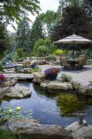create a paradise with a backyard pond pond outdoor living and