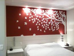 stunning bedroom desig with tree wall decal in red painting wall