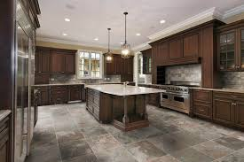 kitchen with brown cabinets large kitchen with hanging small chandeliers over island with