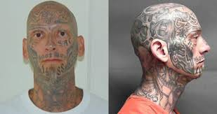us marshals inmate with a history of violence and a head covered