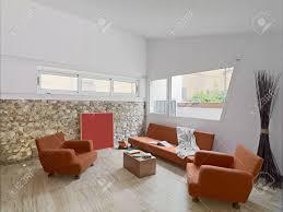 Wohnzimmer Orange Innenansicht Eines Modernen Wohnzimmer Mit Orange Sofa Ans