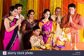 indian family performing ganesh puja on ganesh chaturthi or ganesh