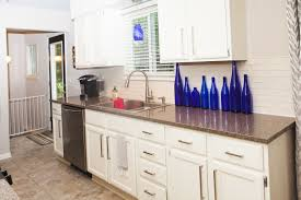 furniture wheat lafata cabinets with oven and natural stone pole