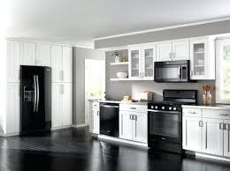 black galaxy granite and white cabinets black and white kitchen