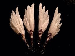 angel wing earrings angel wings feather earrings gold white serpentfeathers