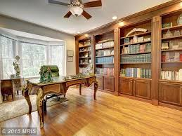 traditional home office with built in bookshelf u0026 high ceiling in