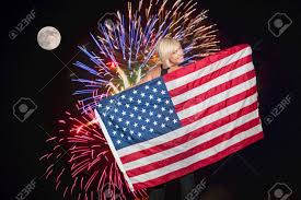 A American Flag Pictures A Beautiful Young Woman Holding An American Flag During A
