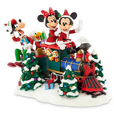 christmas figure santa mickey mouse and friends on train